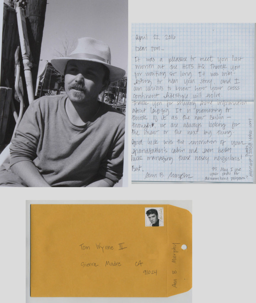 The package for Tom: a handwritten letter and the black and white photo. -