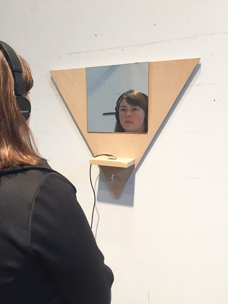 Participant looks in the mirror while listening to me sing Burt Bacharach's